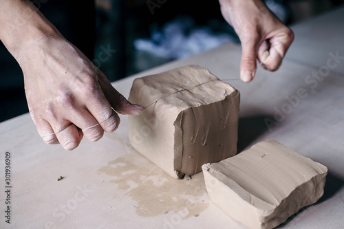 Fotografie, Obraz Female potter hands working with clay in workshop