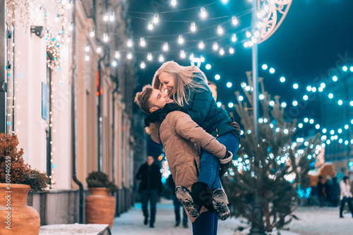Fotografiet  Outdoor close up portrait of young beautiful couple posing on street