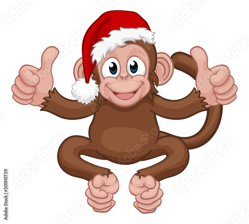 Photo  A Christmas monkey animal cartoon character in a Santa hat giving two thumbs up