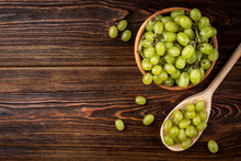 Green Grape On Dark Wooden Bac...