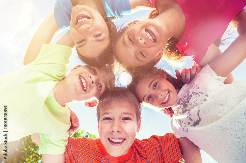 Fototapeta Group of children standing in circle and