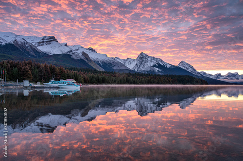Canadian rockies with commercial dock and colorful altocumulus clouds reflection Wallpaper Mural
