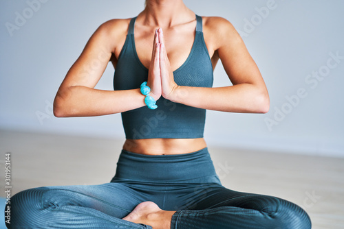 Adult woman practising yoga at home Tablou Canvas
