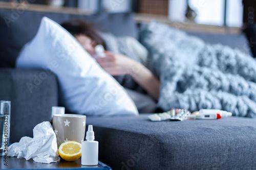 Fotografie, Tablou Closeup nose drops, cup of tea, lemon, medications