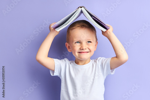 Portrait of joyful caucasian child in casual clothes after education, after reading wants to play Canvas Print