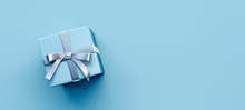 Blue Gift Box With Silver Bow On Light Blue Background 3D Rendering