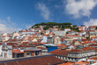 canvas print picture - Cityscape and skyline of Lisbon, Portugal. Castelo de Sao Jorge Castle aka Saint or St George Castle, with rooftops of Baixa, Castelo and Mouraria Districts.