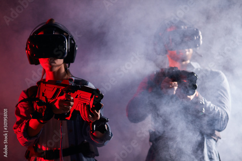 Obraz na plátně  VR gamers with headset, goggles, wearing special equipment with digital devices