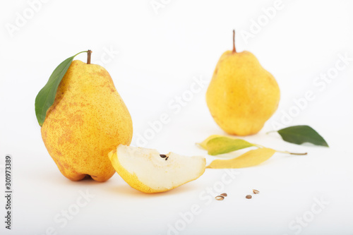 Delicious and juicy Bartlett pears with leaves isolated on white background Wallpaper Mural