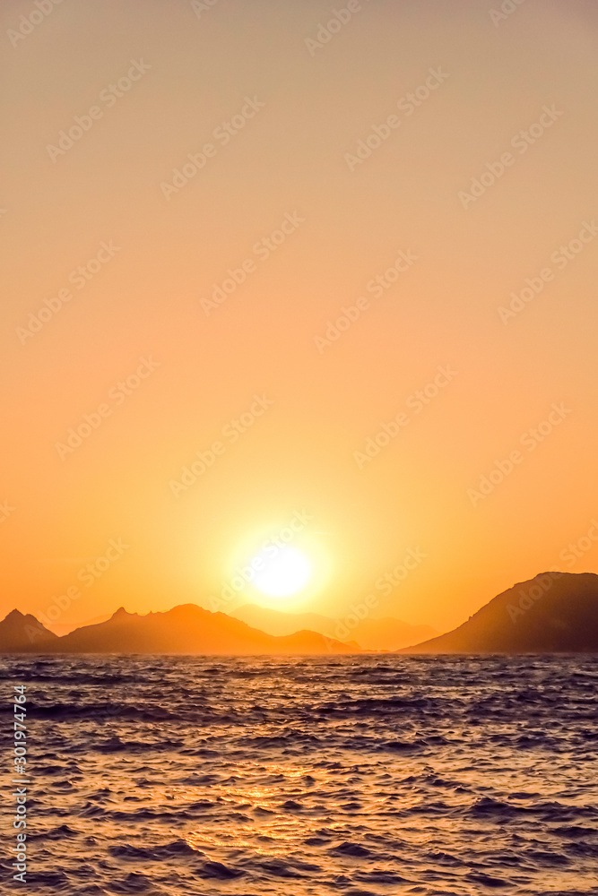 Summer sunset at the Mediterranean sea coast, seascape and mountain view