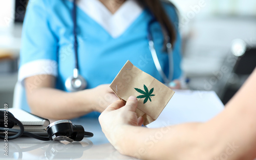 Photo  Female doctor writes prescription for medical marijuana