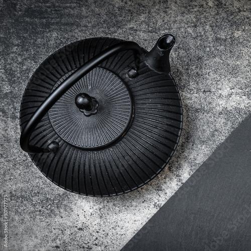 Fototapeta Japanese iron teapot on a grey stone board obraz na płótnie