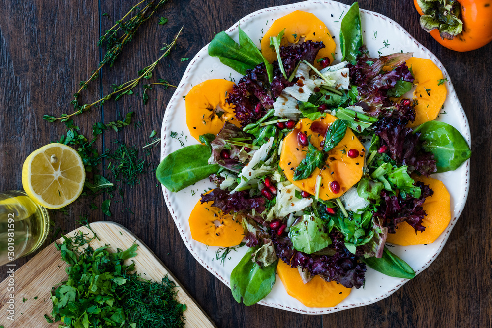 Fototapety, obrazy: Persimmon Fruit Salad with Pomegranate, Lollo Rosso Lettuce, Rocket Arugula or Rucola and Mint Leaves.
