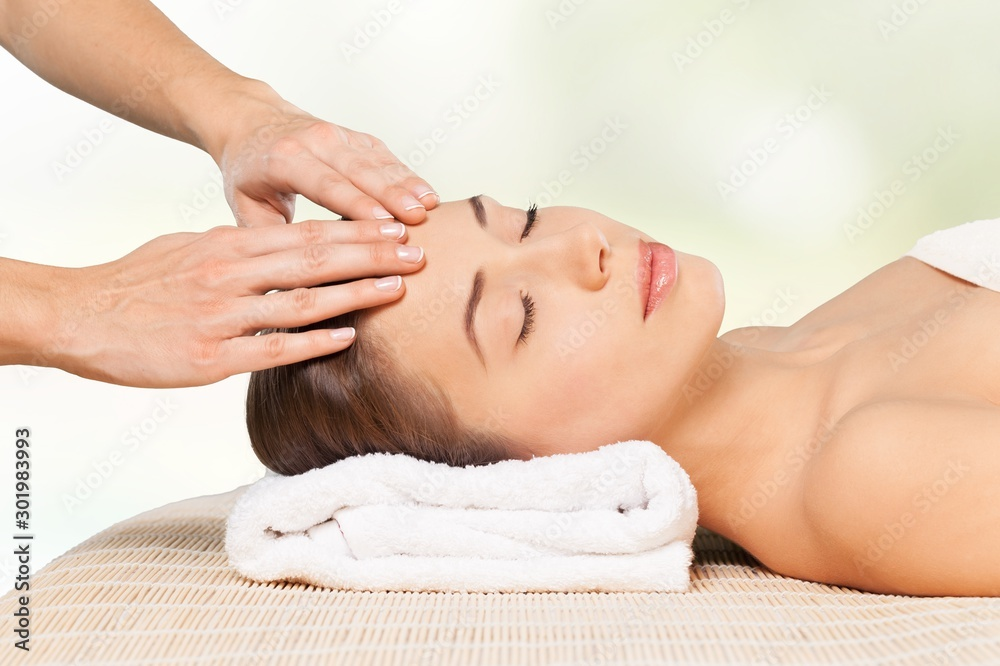 Fototapeta Beautiful young woman relaxing with  massage at beauty spa