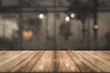 3D Rendering, Wooden top table with bokeh light effect and blur restaurant on background