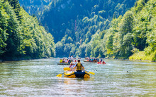Traditional Rafting On The Dunajec River On Wooden Boats. The Rafting Is Very Popular Tourist Attraction In Pieniny National Park