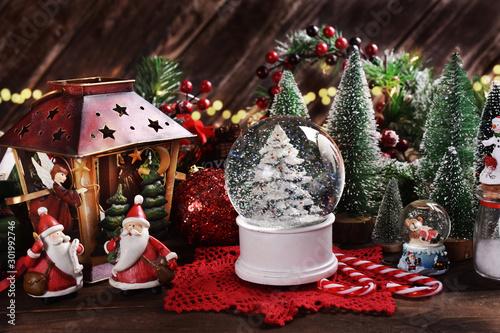 Fotografie, Obraz Christmas glass snowball with Christmas tree inside