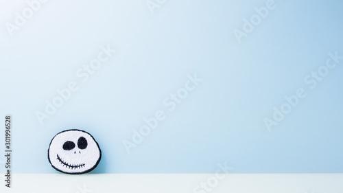Fotografie, Obraz  jack skellington face flat, blue background,copy space.