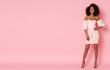 Leinwanddruck Bild Super cute afro-american model in mini dress.