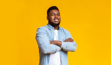 Confident African American Guy Standing With His Arms Crossed
