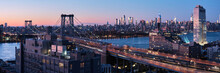 Williamsburg Bridge And Midtown Manhattan Skyline.