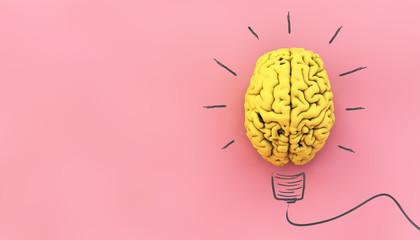 żółty mózg na różowym tle