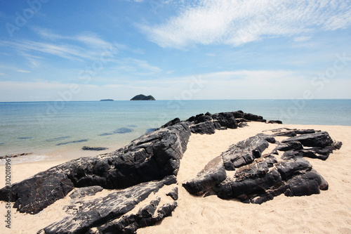 Beautiful seascape of the rocky beach and sea wave on seaside with blue sky at Samila beach in Thailand