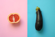 Abstract Symbols For Male And Female Gender (sex) Shown As Half A Grapefruit And An Eggplant