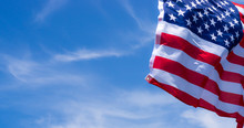 US American Flag On Blue Sky B...