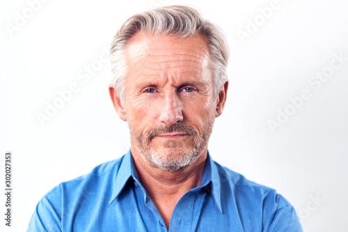 Studio Shot Of Mature Man With Serious Expression Against White Background At Ca Billede på lærred