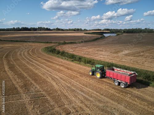 tractor working in field Wallpaper Mural