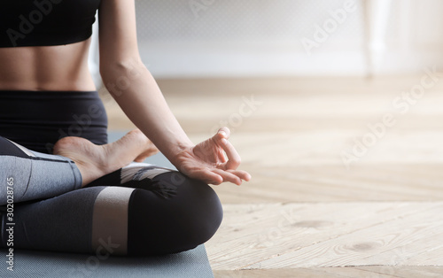 Close up of yoga woman sitting in lotus asana Wallpaper Mural