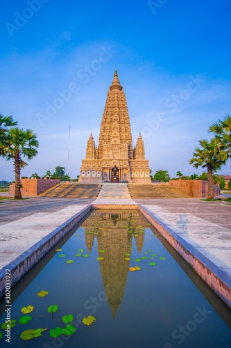 Mahabodhi Temple or Bodh Gaya Pagoda at Wat-Panyanantaram  sunrise and beautiful Wallpaper Mural