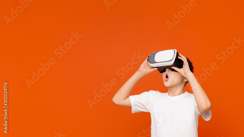 Amazed teen boy experiencing virtual reality in headset Canvas Print