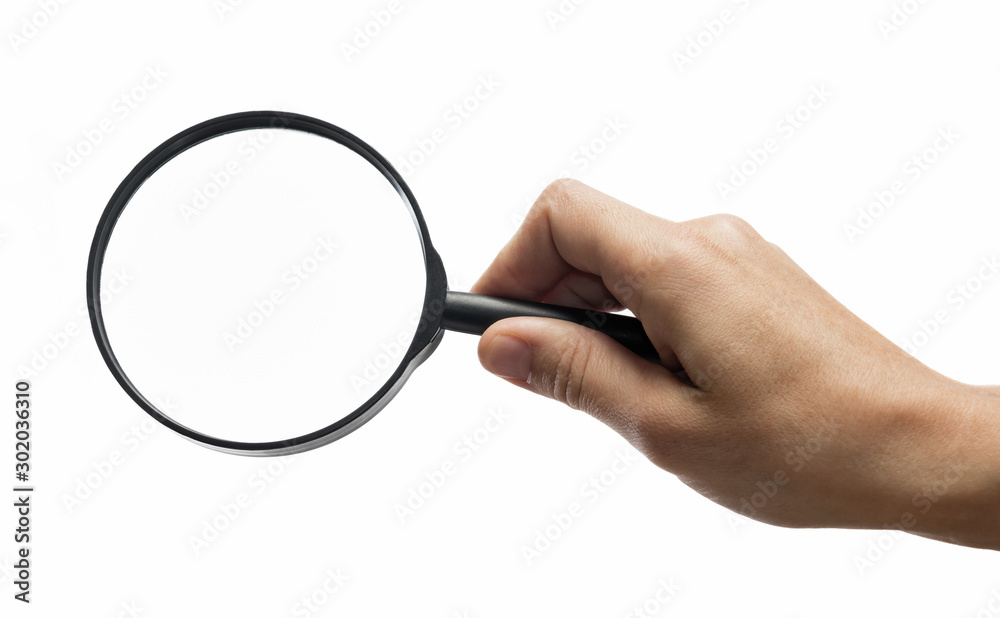 Fototapety, obrazy: Female hand holding the magnifying glass on isolated white background.