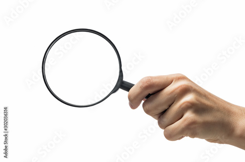 Canvas Print Female hand holding the magnifying glass on isolated white background