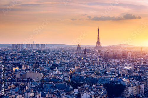 Panoramic aerial view of Paris, Eiffel Tower and La Defense business district. Aerial view of Paris at sunset. Panoramic view of Paris skyline with Eiffel Tower and La Defense. Paris, France. - 302040523