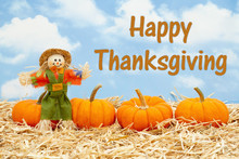 Happy Thanksgiving Message With Scarecrow And Orange Pumpkins On Straw Hay