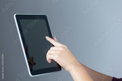 young woman hand holding tablet