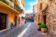 Narrow street in the old town of Bardolino on a sunny day in autumn
