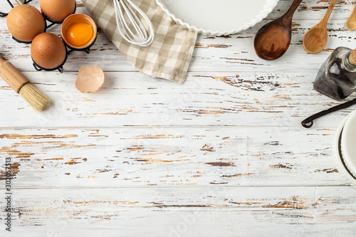 Baking pastry background frame, ingredients, kitchen utensils on rustic wooden b Canvas-taulu