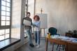 Designers enjoying work in modern spacious office