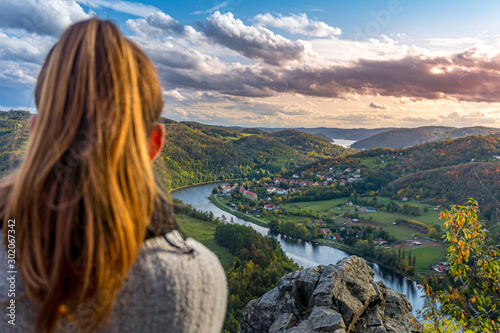 Stampa su Tela Beautiful girl enjoying life and watching the river, mountains and hills during