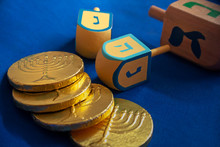 Golden Coins And Dreidels On Blue Background