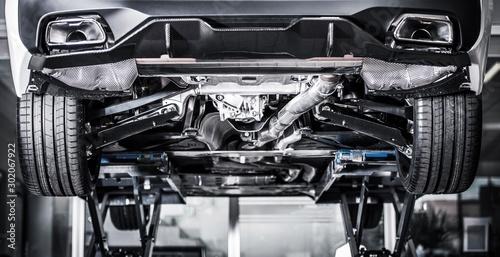 Fotobehang Europa Car on a Vehicle Lift