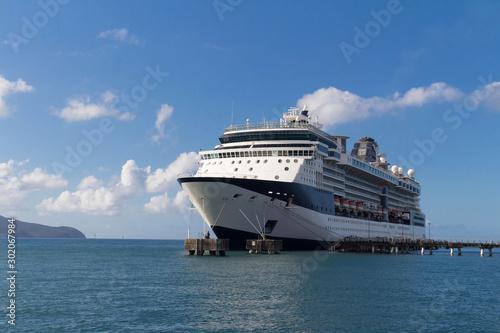 Obraz Large beautiful cruise ship at sea and nice cloudy sky on background - fototapety do salonu