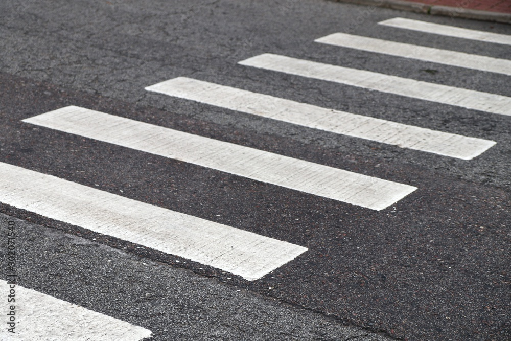 Fototapeta Crosswalk on the asphalt road. Road Safety
