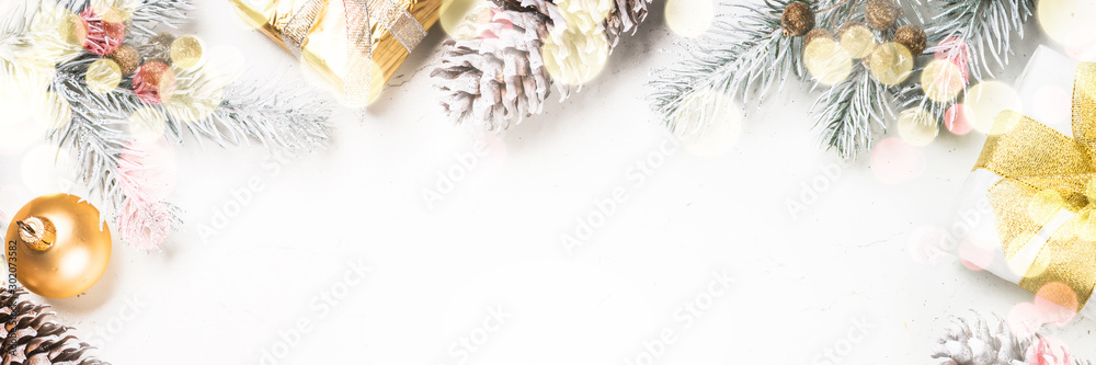 Fototapeta Christmas background with fir tree and decorations on white.