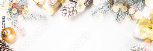 Obraz Christmas background with fir tree and decorations on white. - fototapety do salonu