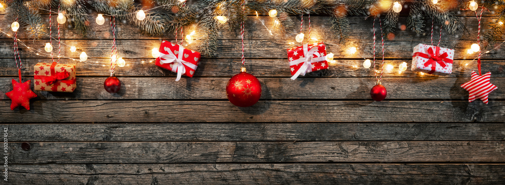 Fototapeta Christmas background with wooden decorations and spot lights.
